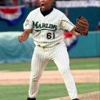 With some help from Eric Gregg's generous strike zone, rookie Livan Hernandez tossed a 15-strikeout three-hitter to outduel Greg Maddux and beat Atlanta 2-1.