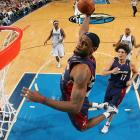 LeBron displays his aerial circus in, appropriately enough, the American Airlines Center in Dallas.