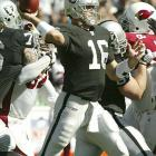 Oakland quarterback Andrew Walter threw for 263 yards, 129 of them to Randy Moss, who scored a touchdown in helping the Raiders get their first win of the season.