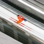 Janne Ahonen of Finland races down the slope at the ski jumping during the Winter Games.