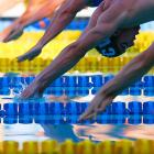 Michael Phelps (black cap) dives into the pool at the start of the 200-meter IM final, which he won at the Santa Clara International.