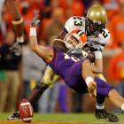 Tyler Grisham of Clemson is tackled by Jay Jones of Georgia Tech.