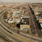 An aerial view of the 2006 New York Marathon shows street congestion from runners rather than vehicles.