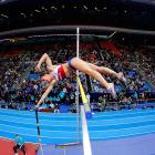 Yelena Isinbayeva of Russia bends over backwards for the gold medal in the women's pole vault final at the 11th IAAf World Indoor Championships in Moscow.