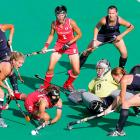 U.S. players duel for the ball against Japan during the women's hockey world cup.