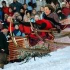 A Bavarian holds on to her rational sleigh in an annual race in southern Germany.