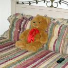 This is Teddy.  Given by her pastor when she had her second knee surgery in high school, Teddy stays propped on Latta's bed.