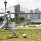 Beckham is a world-wide phenomenon, thanks to his fame and media-savvy. Here he's in New York, bending it across the Brooklyn Bridge during a photo shoot for adidas.