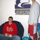 Welcome to the University of Washington. Spencer Hawes (left), the leading scorer on the UW men's basketball team, invited us over to check out his apartment. The 7-foot center shares his place with fellow freshman Phil Nelson (right), who also starts for the Huskies. Let's check out the crib...