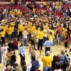 Arizona State fans storm to court after the Sun Devils 68-58 win over USC. The victory marked ASU's first Pac-10 win of the season.