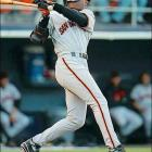 While Mark McGwire and Sammy Sosa were turning baseball upside down with the home run race, Bonds had a typical season: .303 average, 37 home runs, 122 RBIs.