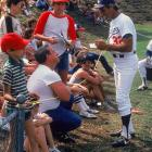 Hall of Famer Sandy Koufax interacts with fans in 1982.