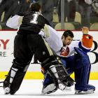 "This set-to summoned echoes of Mike Tyson's 30-second KO of Marvis Frazier in 1986 as Pittsburgh backup Brent Johnson fulfilled an apparent dream (""It was something I've kind of wanted to do for a while."") after taking umbrage at counterpart Rick DiPietro swatting Matt Cooke. Johnson skated down the ice and dispatched the arrogantly grinning Isles netminder with a crisp left to the noggin, much to the glee of his Penguin comrades. Click here to watch the fight!"