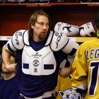 Saturday 6:24PM<br> Peter Forsberg straps on his equipment before the sold-out game against the Red Wings. Forsberg later posted his first point as a Predator (assisting on Paul Kariya's first-period score) before scoring his first goal as a Pred, as he potted a backhand pass from Kariya at 2:11 of overtime for a 4-3 win that pushed Nashville past Detroit and into first place in the Central.