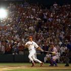 The pursuit of the single-season home run mark of 61 held the nation in thrall all summer as Mark McGwire and Sammy Sosa went at it tater for tater.