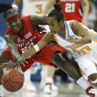 Tennessee's Shannon Bobbitt and Rutgers' Matee Ajavon fight for a loose ball. Bobbitt hit four 3-pointers and finished with 13 points for the Lady Vols.