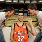 In this SIOC photo shoot from October 2005, Jason Cain of the basketball team posed with two members of his fan club.