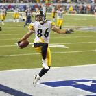 This shot shows Pittsburgh's Hines Ward scoring a touchdown in Super Bowl XL. I was shooting from the stands. You can sit and not have a play happen like this the entire game. But fortunately, after seeing a great pass and great catch, with Ward coming into the end zone, there was the celebration to add a special touch. This kind of emotion is what I identify with the Super Bowl. I was very lucky to be in the right corner.<br><br>Shot with: Canon EOS-1D Mark II N, EF 70-200mm f/2.8L IS USM zoom lens