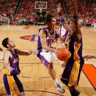 I took this photo during Game 1 of the Suns-Lakers series this postseason. Steve Nash (13), the Suns' point guard, is absolutely amazing to me. In my own mind, I thought he deserved the MVP award this season. He should also get an ironman award for all the physical abuse he takes.  <br><br>Shot with: Canon EOS-1Ds Mark II, EF 35mm f/1.4L USM lens