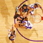 This shot, of the Cleveland Cavaliers and Phoenix Suns, was taken from the catwalk. In basketball, any battle for the ball presents great faces and compositions. We decided that instead of doing the usual point of focus -- the circle and the basket -- we'd do a longer horizontal view to get the entire lane. It just gives a little different look, a nice look for basketball.<br><br>Shot with: Canon EOS-1Ds Mark II, EF 70-200 f/2.8L IS USM lens
