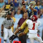This catch by UCLA's Marcus Everett, over Utah's Bruce McCain, is a huge passing play that really broke the game open for the Bruins. I was shooting from the end zone and literally waiting for the action to come toward me. But this happened on the other sideline. I was able to react to it and make a picture of a Bruins touchdown.<br><br>Shot with: Canon EOS-1D Mark II N, EF 400mm f/2.8L IS USM lens