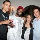 Golden State Warriors' Matt Barnes (left) and Baron Davis hang with a couple of their biggest fans, Jessica Alba and boyfriend Cash Warren.