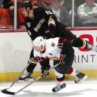 Ryan Getzlaf tries to get around Daniel Alfredsson during the first period.