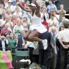 """SIMON SAYS:   """"I was courtside here at the ladies' Wimbledon final in 2005. No one had expected Venus Williams to get to the final, let alone to win it. (She beat Lindsay Davenport in three sets.) Raw emotion is what you're looking for at these big finals, and Venus's reaction typified what you're after.""""  Shot with a Canon EOS-1D Mark II, EF 200mm f/2.8L II USM"""