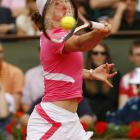 Justine Henin is one win away from her third straight French Open title after defeating Jelena Jankovic 6-2, 6-2.