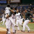 The Devil Rays' Akinori Iwamura is congratulated after scoring the winning run on a single by  Elijah Dukes in the bottom of the ninth against the Tigers on May 28 at Tropicana Field. Tampa Bay won 6-5 in Iwamura's first game back with the D-Rays after missing over a month with an oblique injury.