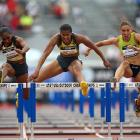 In a race that featured the world's top two hurdlers, 2007 world leader and defending U.S. champion Ginnie Powell (center) prevailed over reigning world champion Michelle Perry. Powell took an early lead and stayed strong through the finish, winning in 12.63 with Perry at 12.72. U.S. indoor champion Lolo Jones was third in 12.79.