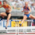 Yvonne Wisse (left) of the Netherlands and Salla Rinne of Finland during the 100m hurdles portion of the heptathlon on Day 1.