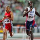 Kerron Clement of the U.S. and Felix Sanchez of the Dominican Republic race to the finish in the 400m hurdles.
