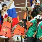 Yelena Isinbayeva celebrates defending her world title in the pole vault.