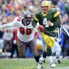 "This playoff game at Lambeau may not have been one of Favre's statistical bests â€"" 15 of 28 for 198 yards and a touchdown - but it was an example of Favre's dominance of Warren Sapp and the outstanding Buccaneers defense. With Sapp yapping in his ear all game, Favre remained steady and led the Packers to a 21-7 divisional-playoff win en route to their second straight NFC championship."