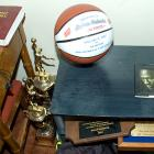 """Instead of boasting his accomplishments in glass cases, B-Rob humbly keeps his trophies, plaques and """"1,000 point club"""" ball against the wall on the ground."""