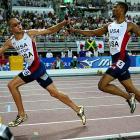 Darold Williamson (handing off) and Jeremy Wariner helped the U.S. 4 x 400-meter team win in 2:55.56.