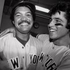 On July 19, the Red Sox led the Yankees by 14 games. New York went 52-21 down the stretch to tie Boston for first place in the AL East. The Yankees won a one-game divisional playoff thanks to Bucky Dent, right, and Reggie Jackson. A three-run homer by Dent gave the Yankees a 3-2 lead in the 7th and a solo shot by Jackson in the 8th helped the team hold on to win 5-4.