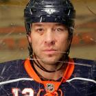 The New York Islanders' notorious enforcer proudly displayed the battle scars of his rugged 16-year hitch in the National Hockey League.