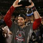 World Series MVP Mike Lowell holds up his hardware after having a standout postseason.