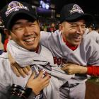 Daisuke Matsuzaka and Julian Tavarez sport their new gear as they kick off Boston's celebratory festivities.