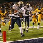 One win away from the national title game and playing on its home turf, West Virginia entered the 100th Backyard Brawl as a four-touchdown favorite. But Pat White injured his thumb in the second quarter, causing the explosive Mountaineers' offense to stall, and West Virginia became the sixth second-ranked team to lose to an unranked opponent this season.