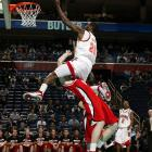 Maryland's Ekene Ibekwe goes right over the top of a Davidson defender in an attempt at getting to the basket during a 1st round NCAA tourney game in Buffalo. This is a low angle remote camera triggered via radio from beneath the press table.