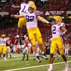 After a field goal cut into the Ohio State lead, LSU tied the game 10-10 thanks to tight end Richard Dickson (82), who celebrated his touchdown reception with receivers Brandon LaFell (1) and Demetrius Byrd.