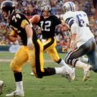 In spiriting the Steelers to a thrilling 35-31 decision over the Cowboys, Bradshaw established since-broken Super Bowl records with four touchdowns and 318 yards passing.