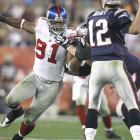 Justin Tuck (91) had two of the Giants' five sacks as they held the record-setting Pats' offense to a season-low 14 points.