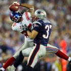 With Rodney Harrison doing his best to break up the pass, David Tyree leaped in the air and brought the ball down with it pinned against his helmet.