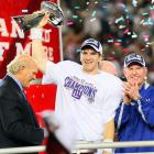 as Eli followed in older brother Peyton's footsteps after passing for 255 yards and two touchdowns.