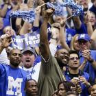 Former Memphis Tiger and NBA star Penny Hardaway (left) celebrates with fans during the second half of this semifinal game against UCLA.