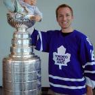 """This picture of my daughter and I was taken 3 years ago at a charity event in my office building.  When the cup arrived I asked half jokingly to the assistant if he'd let me put my baby girl in the cup.  He said 'sure, no problem'.  So I had to call my wife to drop what she was doing and bring Madelyn and my Leafs jersey to work! "" -- Colin Brown"